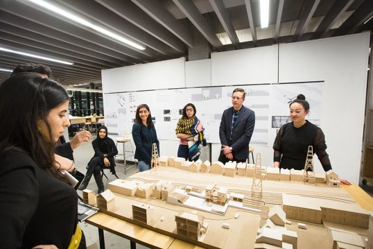 Architecture students attending a review