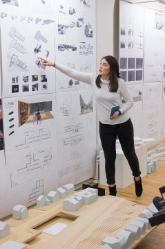 Architecture student with posters