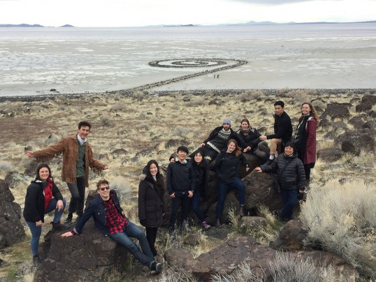 brigitte shim and students pose in front of spiral jetty in Utah during a reading week trip