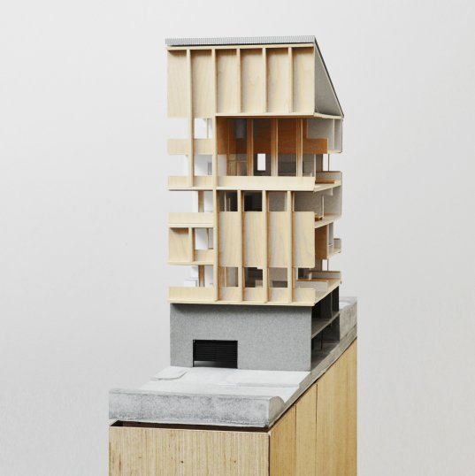 A model showing the interiors of three stacked dwelling units