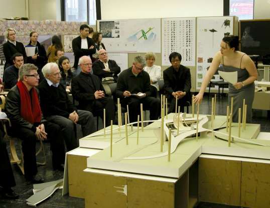 a student presents an architectural model