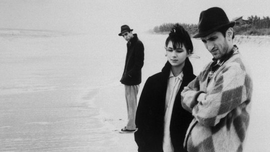 film still from stranger than paradise of three people on a beach